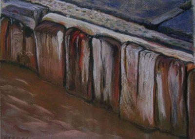 La petite palissade de bois au pied de la digue